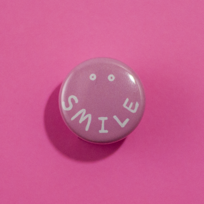 front view of smile button