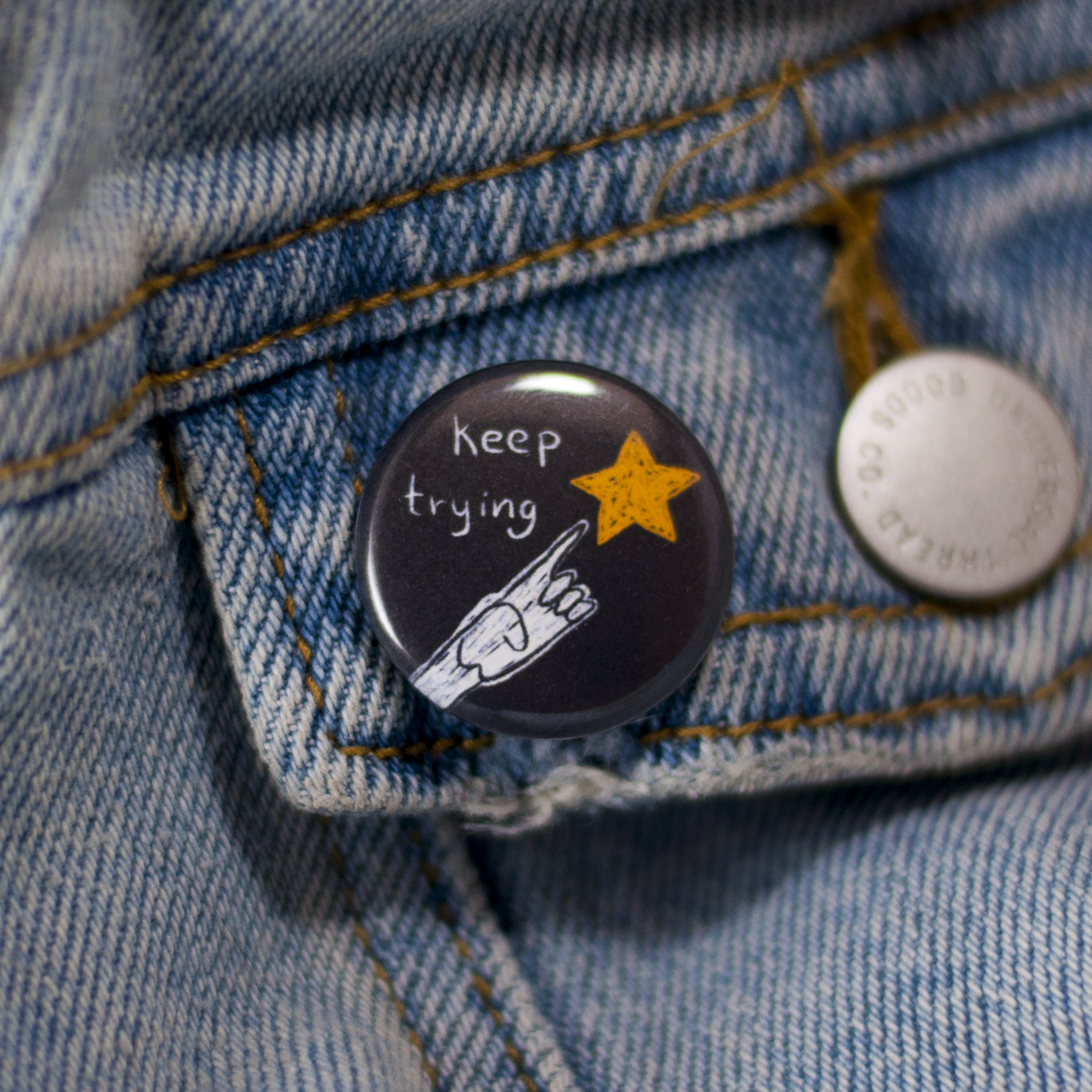 try button worn on jean jacket